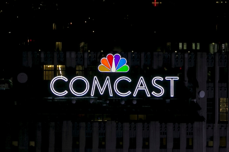 Image: A Comcast logo on top of 30 Rockefeller Plaza in Manhattan