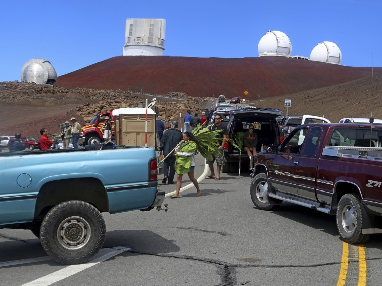 Protesters block vehicles from getting to the Thirty Meter Telescope groundbreaking ceremony site at Mauna Kea, Hawaii, on Oct. 7, 2014.
