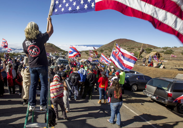 Protesters block the road near the Thirty Meter Telescope construction site on June 24, 2015, atop Mauna Kea.