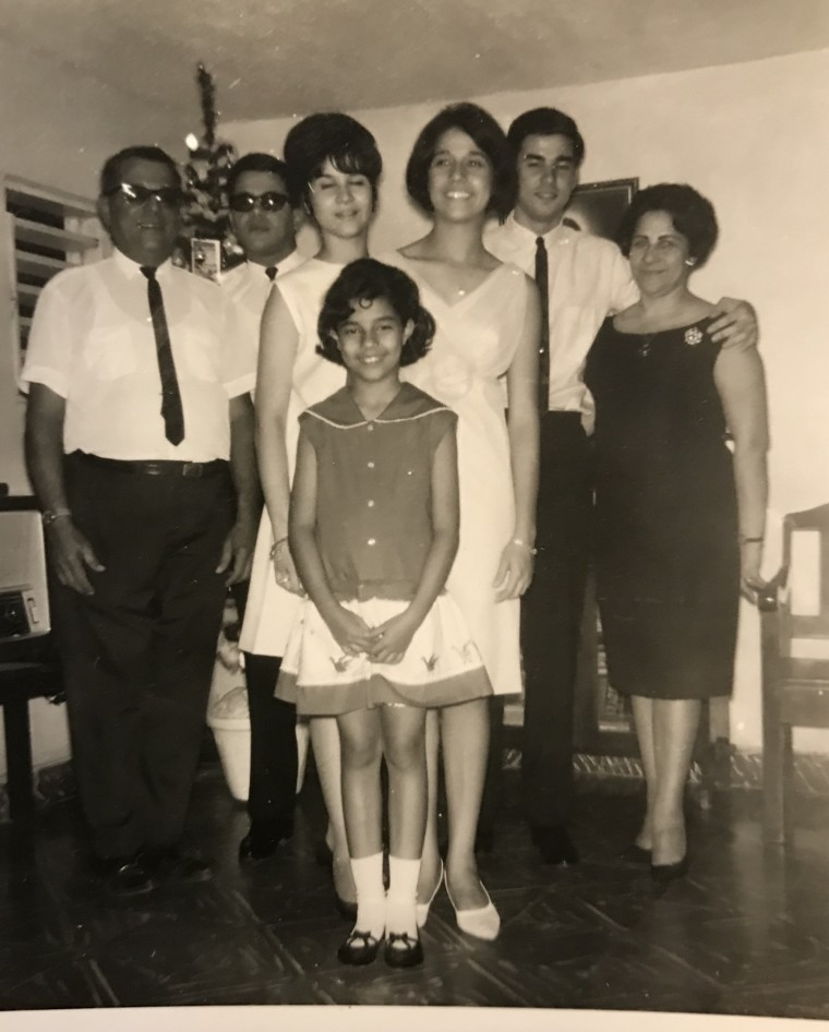 The Contin family in Santo Domingo, Dominican Republic in 1966. Maximo with his arm around his mother and sister Mayra next to him.