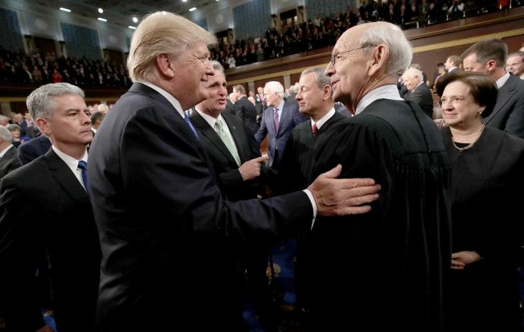 Image: U.S. President Donald Trump greets Supreme Court Associate Justice Stephen Breyer