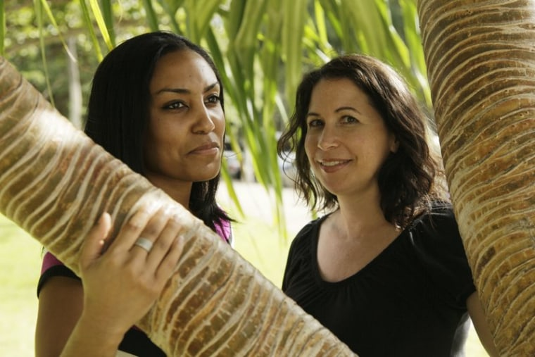 Taeko Bufford, left, and Diane Cervelli, right, pose for a photo near Waikiki beach in Honolulu.