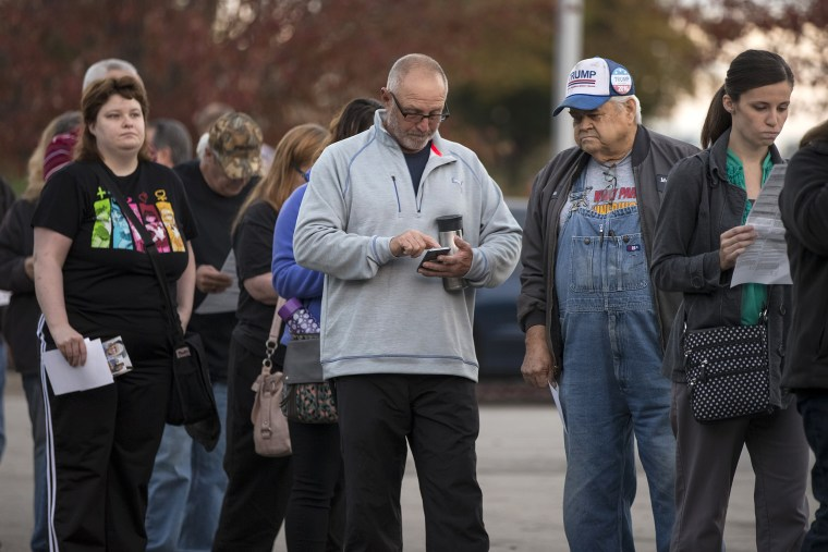 Image: Voters wait in line to cast their ballots at the Midwest Genealogy Center Library on Nov. 8, 2016 in Independence, Missouri.