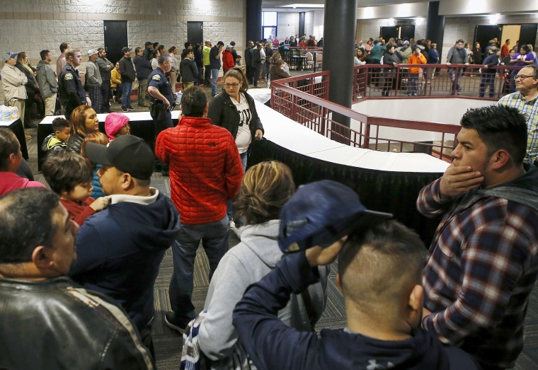 Image: People lineup inside the Dalton Convention Center to pick up their children