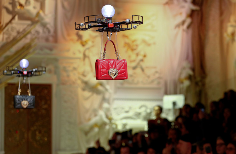 Image: Drones carry bags at the Dolce & Gabbana Autumn/Winter 2018 women's collection