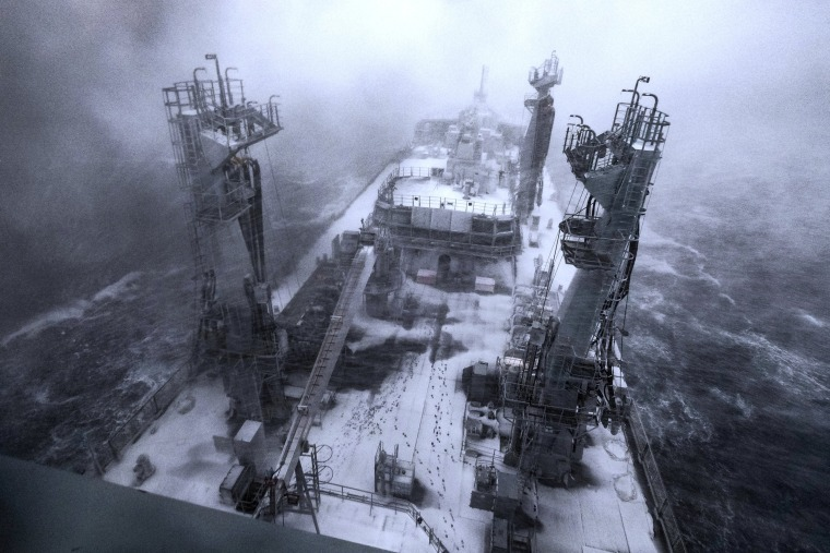 Image: Snow covers the deck of the Royal Fleet Auxiliary Tidespring during bad weather