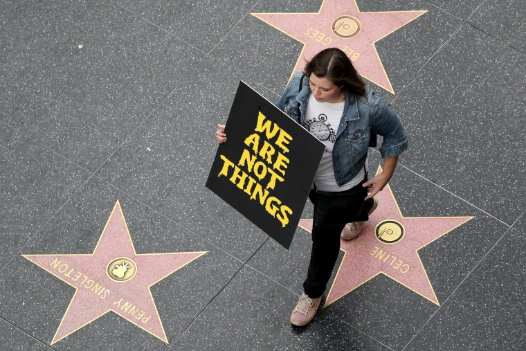 Image: A demonstrator takes part in a #MeToo protest march for survivors of sexual assault and their supporters on the Hollywood Walk of Fame in Hollywood, Los Angeles, on Nov. 12, 2017.