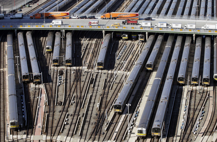 Image: Trains are parked in a rail yard on New York's west side