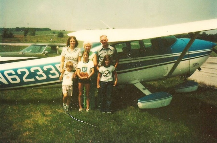 The Zarda family stands in front of an airplane during the mid-1970s. Mom (Shirley Zarda), Grandma (Elma Greer), Grandpa (Vester Greer), in front - (Donald), sister (Kimberly Zarda), sister (Gara Zarda).