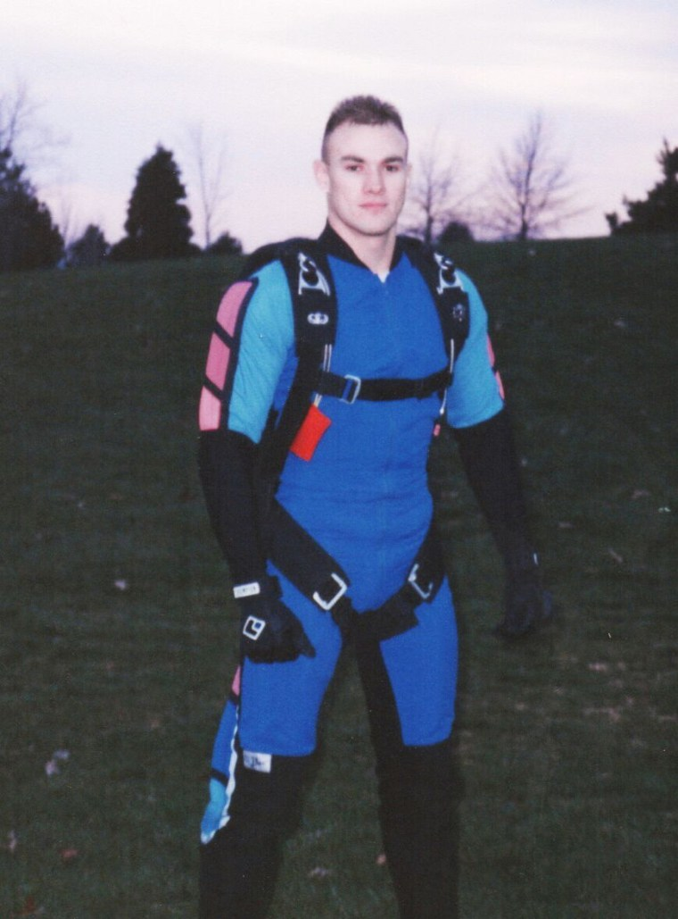 Donald Zarda poses for a picture in his skydiving jumpsuit.