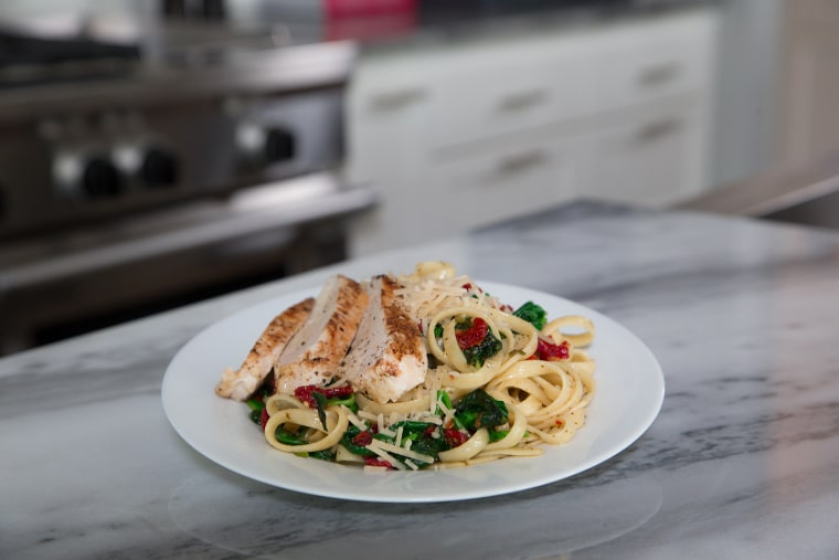 Basil garlic chicken fettuccini with spinach meal kit.