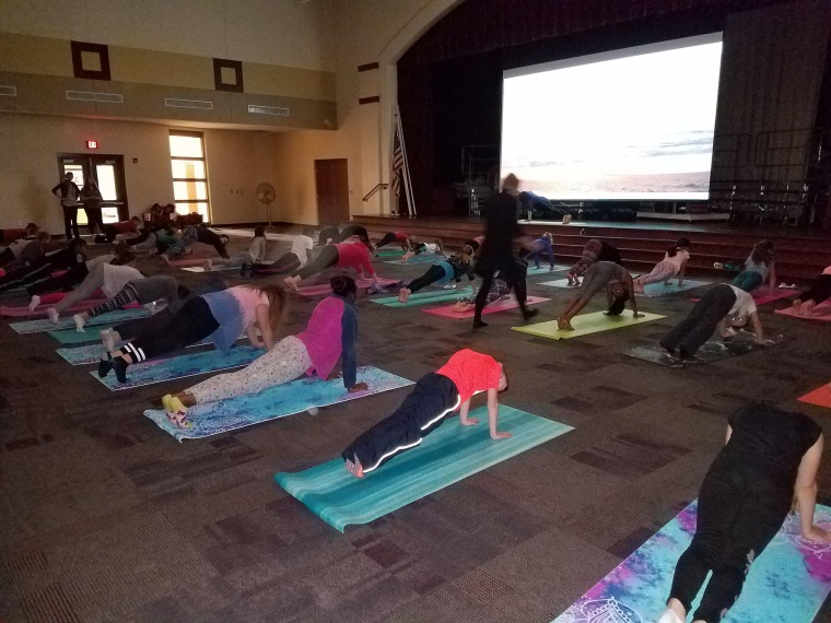 Tina DuBrock realized her students experienced loads of stress, even starting in kindergarten. She started a yoga program and were stunned that 120 students showed up for it.