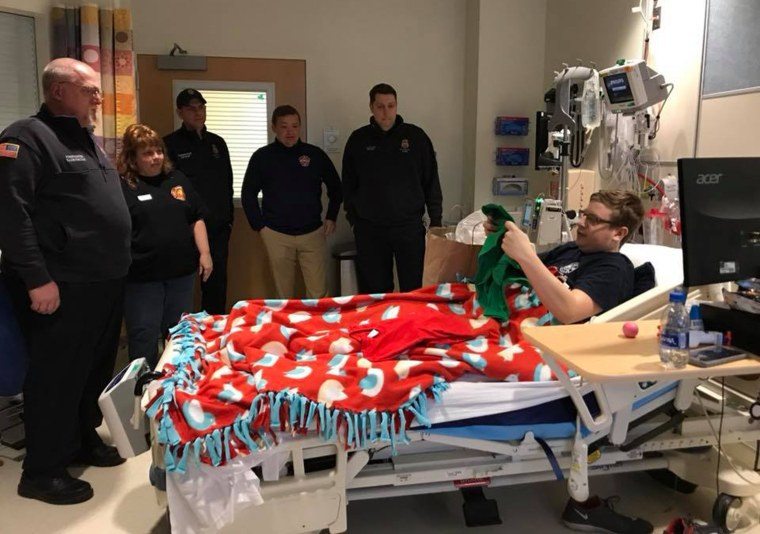 "The ""brothers"" of Rescue 1 and Ladder 6 in Buffalo stopped by to visit Timothy Richardson in the hospital."