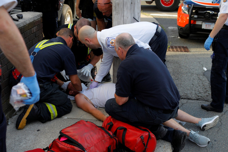 Image: Paramedics and Firefighters Treat Unresponsive Man