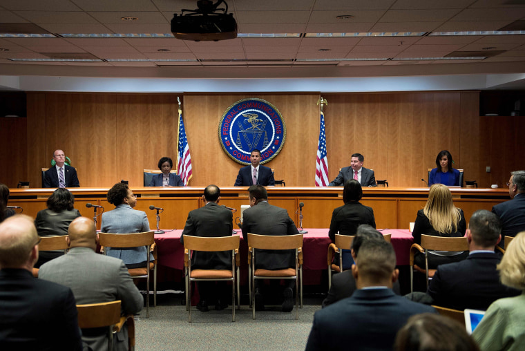 Image: FCC Chairman Ajit Pai and commission members take their seats