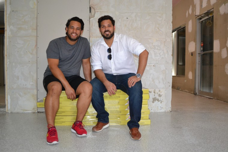 David Flores (L) and Ivan Nieves (R) inside the space they're renovating to open up their business in Miami's MiMo district. They left Puerto Rico in October.
