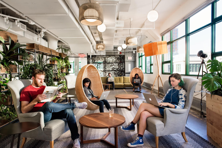 Image: Employees sit on cocoon-like chairs at Etsy's office in Brooklyn