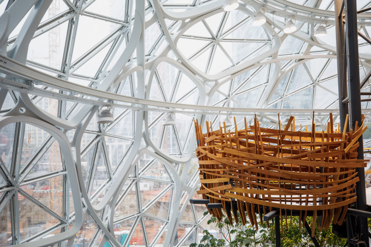 Image: A meeting space shaped like a bird's nest is perched high inside Amazon's Spheres in Seattle