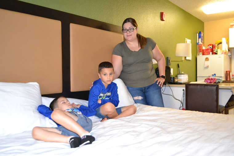 Jackeline Soto Perez, with her two young sons, at the Miami hotel where they are staying through FEMA's Transitional Shelter Assistance program, March 5, 2018.