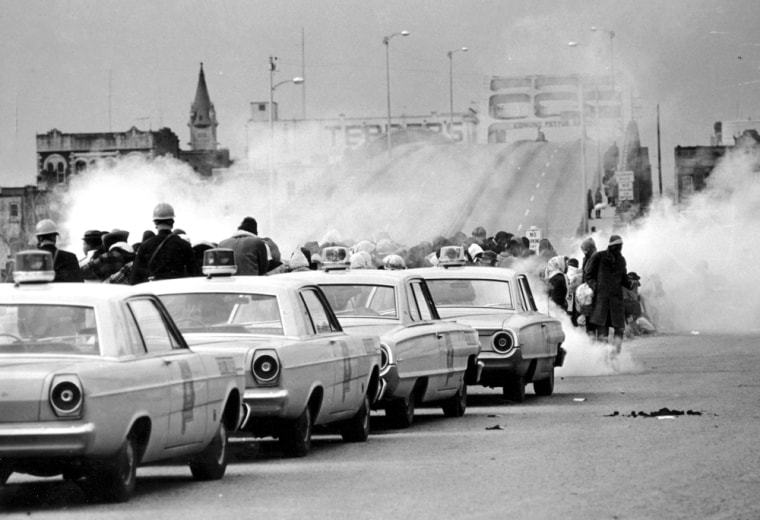 Image: Tear gas fumes fill the air as state troopers, ordered by Gov. George Wallace, break up a demonstration march in Selma, Alabama