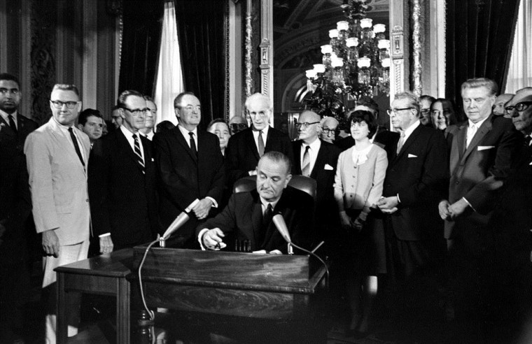 Image: President Johnson signs the Voting Rights Act on Aug. 6, 1965