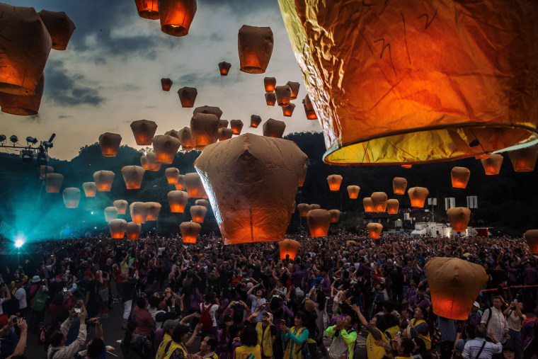 Image: Tourists release thousands of lanterns during a festival to celebrate the last day of the Lunar New Year