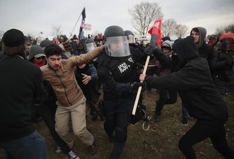 Image: Police clash with demonstrators as they escort people to a speech by white nationalist Richard Spencer at Michigan State University