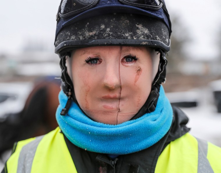 Image: Trainer Lawney Hill wears tights over her face to keep out the cold