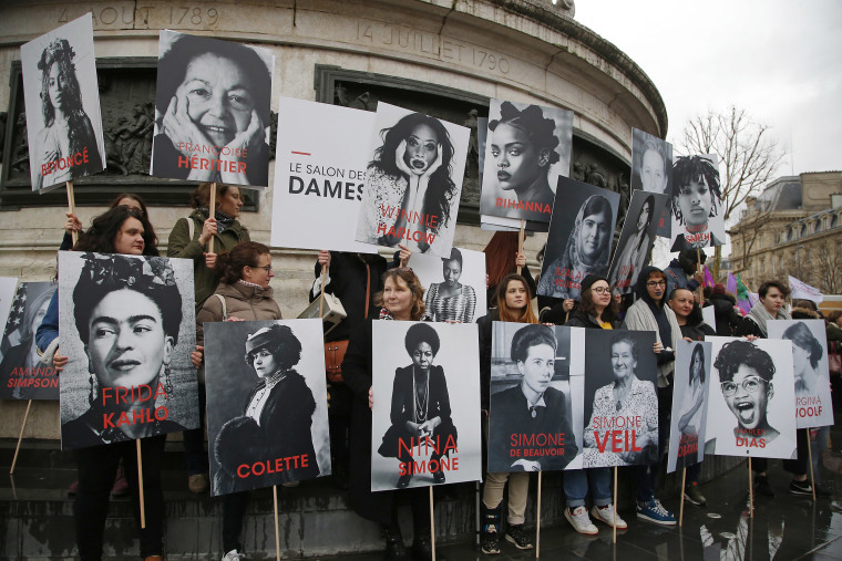 Image: Women hold posters of famous feminists