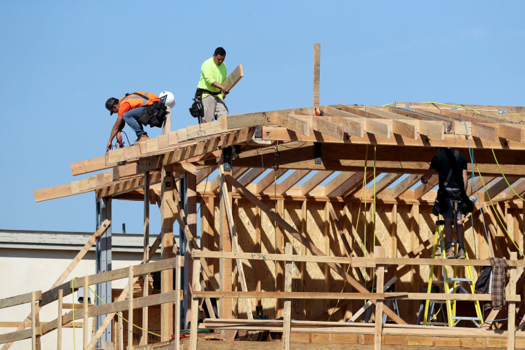 Image: Construction workers build a new home in Manhattan Beach