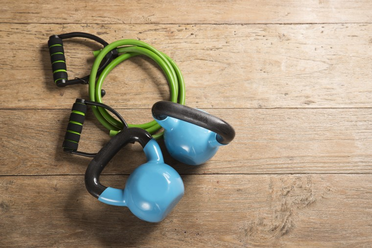 Image: Flat Lay image of kettlebells on a wooden floor.