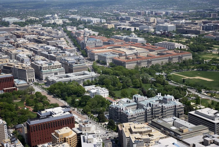 Aerial view of White House, Old Executive Office Building, Pennsylvania Avenue and the U.S. Capitol,