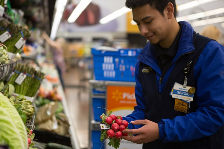 Walmart personal shoppers handle grocery deliveries.