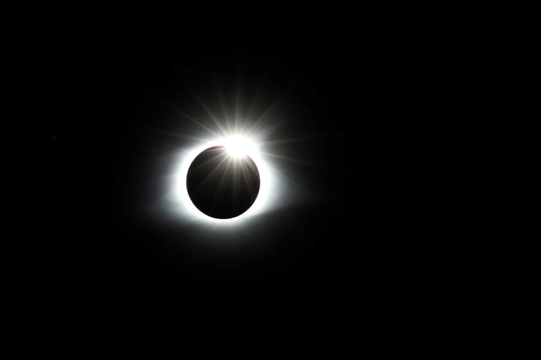 Image: The solar eclipse creates the effect of a diamond ring at totality as seen from Clingmans Dome in the Great Smoky Mountains National Park, Tennessee
