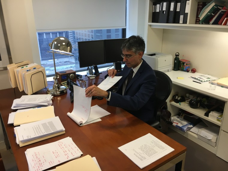 Adeel A. Mangi at his desk at the law firm Patterson Belknap Webb & Tyler, where he is a litigation partner.