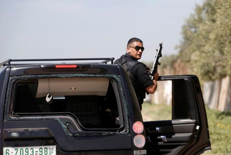 Image: A damaged vehicle belonging to Rami Hamdallah's convoy