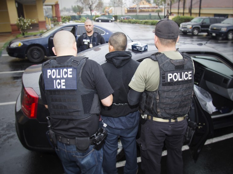 Image: Foreign nationals are arrested during an ICE targeted enforcement operation