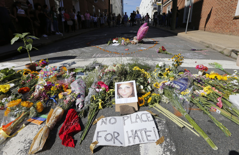 Image: A makeshift memorial of flowers and a photo of victim Heather Heyer