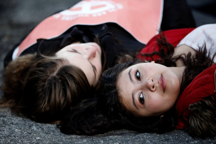 Image: Students from Fiorello H. Laguardia High School lie down on West 62nd street in support of the National School Walkout in the Manhattan borough of New York City