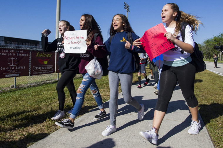 Image: Students from Westglades Middle School walk out of class