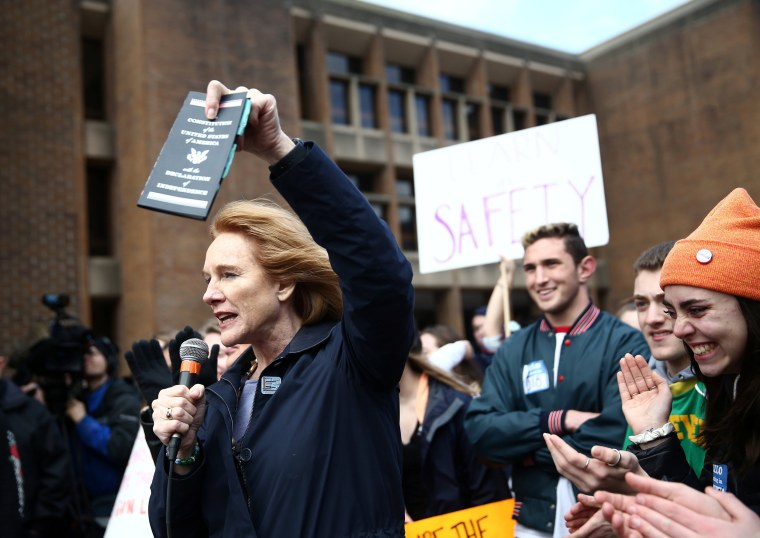 Image: Durkan holds Consitution while speaking during National School Walkout to protest gun violence in Seattle