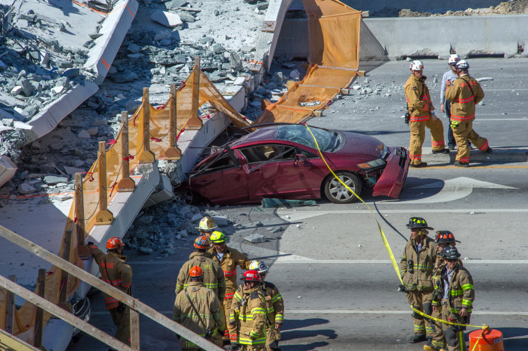 Image: A pedestrian bridge collapses crushing vehicles underneath in Miami