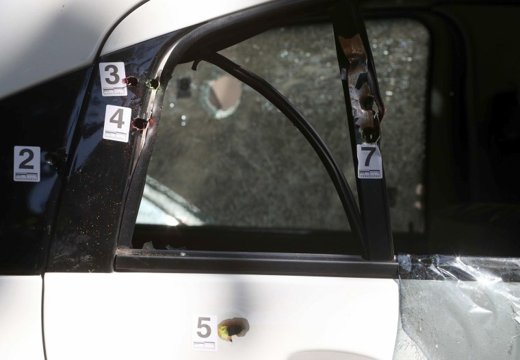 Bullet holes are tagged on the car in which Franco was travelling when she was murdered.