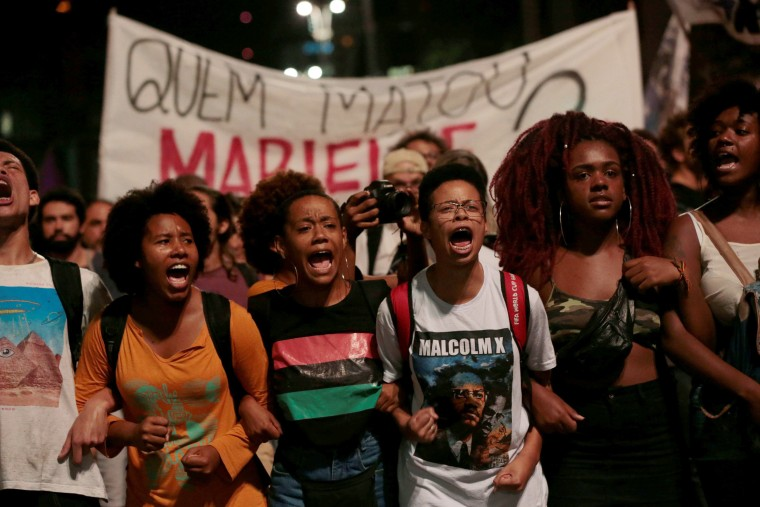 People take part in a rally against Franco's murder, in Sao Paulo.