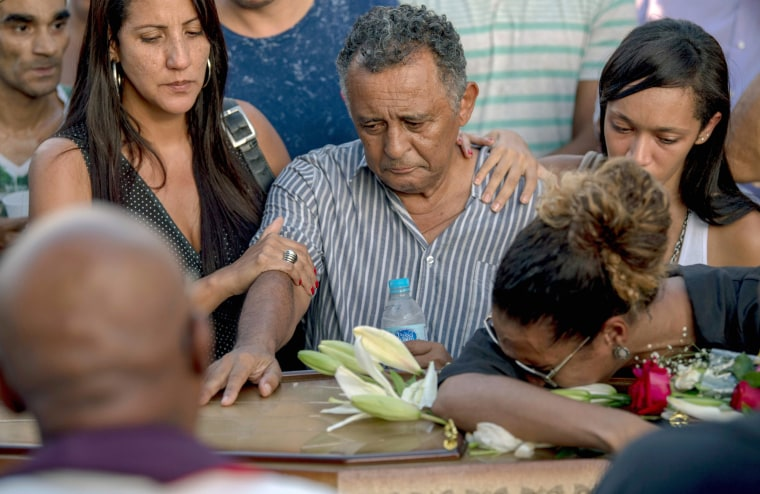 Relatives of the councilwoman and activist pay tribute during her funeral at Caju Cemetery in Rio de Janeiro.