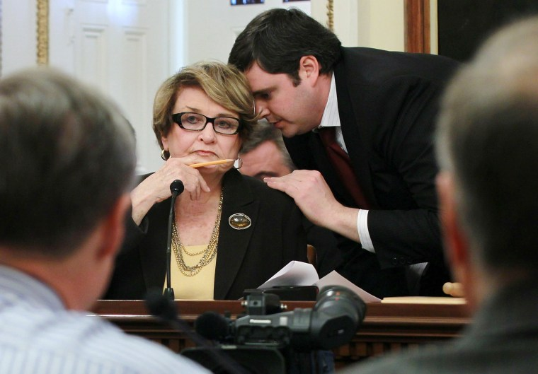 Image: Louise Slaughter listens to an aide during a markup hearing