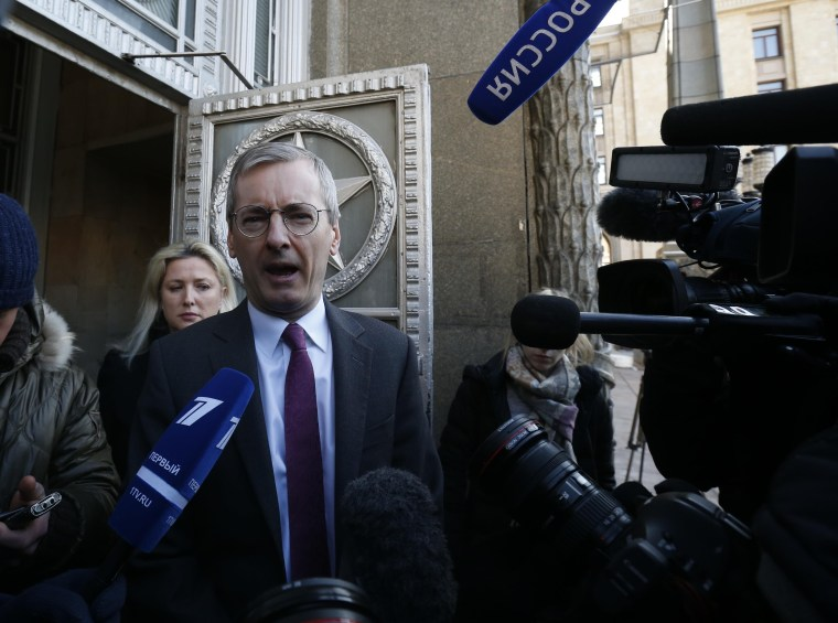 Image: British Ambassador to Russia Laurie Bristow leaves the Russian Foreign Ministry in Moscow