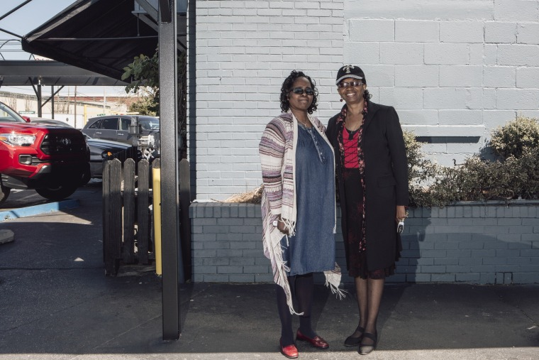 Image: Cassandra Gooley, left, and Cynthia Ray, right, stand for a portrait after having lunch at Niki's West in Birmingham, March 14, 2018. African-American women are running in higher numbers in Jefferson County, Alabama.