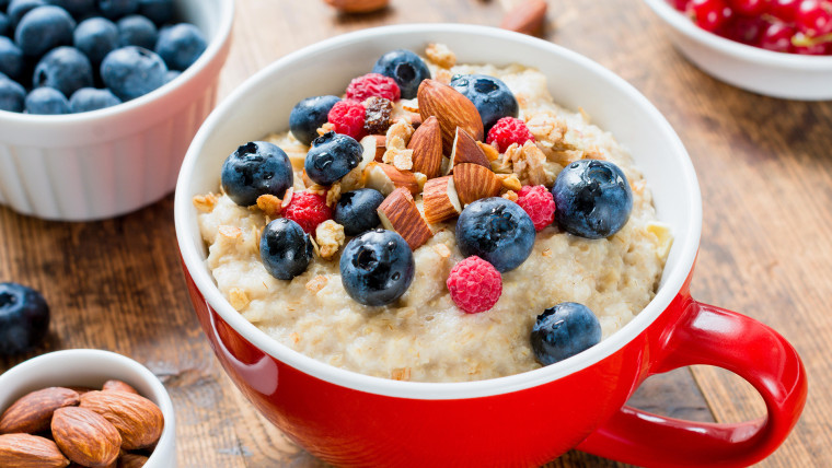 Oatmeal porridge with fruits and nuts for healthy breakfast