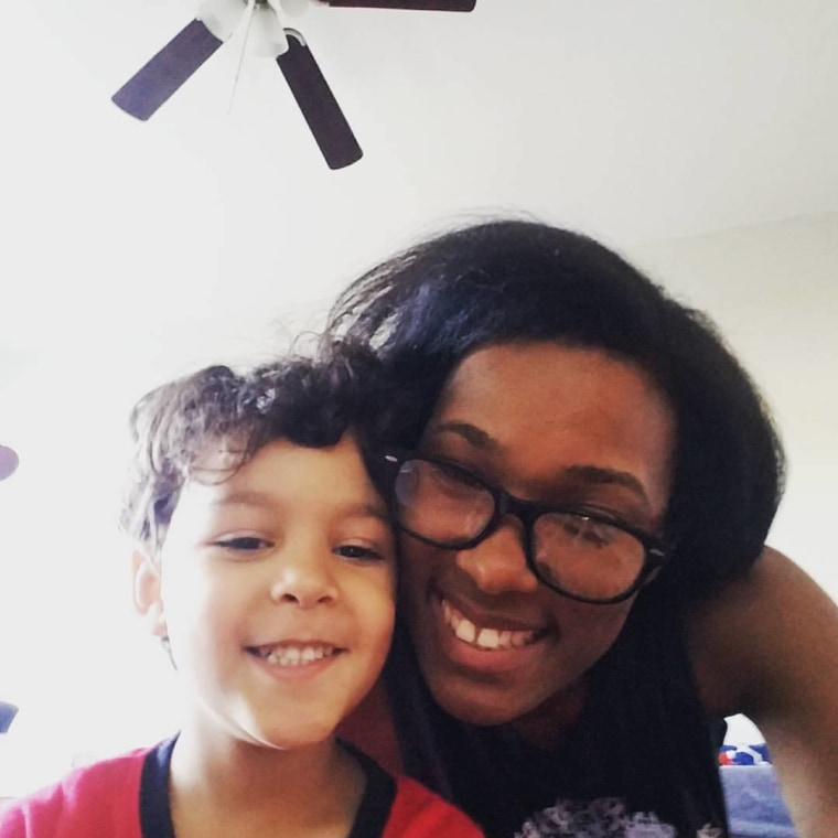 """Writer Sa'iyda Shabazz, pictured here with her 4-year-old son, said of """"Black Panther,"""" """"Someone took the time to give them someone they can relate to. It's more than just admiring the superhero because they saved the world from the bad guys; it's because they saved the world from the bad guys in skin that is brown."""""""